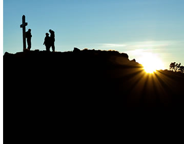 Several hikers at the top of Volcan Baru during sunrise